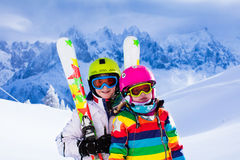 Kids skiing in the mountains Stock Images