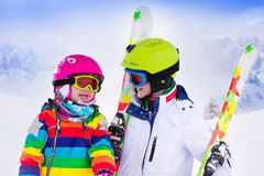 Kids skiing in the mountains Royalty Free Stock Photos
