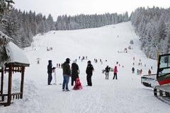 Kids skiing on a ski slope for children in winter resort in mountain of Vitosha, Bulgaria – jan 23,2018. Skiing, ski sport. Winter sports in mountain royalty free stock photography