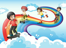 Kids in the sky playing with the rainbow Stock Photography