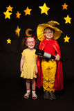 Kids in sky watchers costumes with a telescope Royalty Free Stock Image