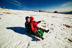 Kids on sled Stock Photo