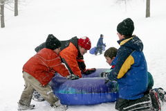 Kids Sledding. Four Boys Having Fun Sledding Stock Photography