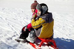 Kids on sledge Royalty Free Stock Image