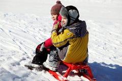 Kids on sledge Royalty Free Stock Image