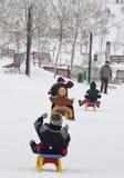 Kids on the sledge Stock Photo