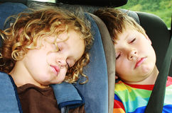 Kids sleeping. Kids fall asleap in the backseat Stock Photo