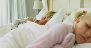 Kids sleeping on bed 4k. Kids sleeping on bed in bedroom 4k stock footage