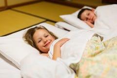 Kids sleeping in Japanese room Royalty Free Stock Image