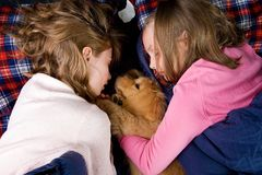 Kids sleeping with puppy Royalty Free Stock Photography