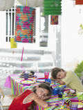 Kids Sleeping At Table After Birthday Party Stock Photo