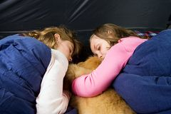 Kids sleeping in a tent Stock Images