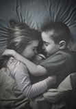 Kids Sleeping Together at Night in Bed Royalty Free Stock Images