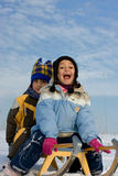 Kids on sleigh Royalty Free Stock Images