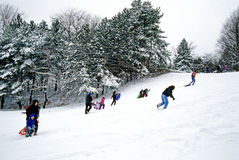 Kids sleigh riding. Inclined plane; kids sleigh riding, upstate New York Stock Photography