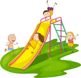 Kids on a slide royalty free stock photography