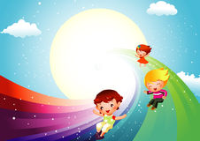 Kids sliding on rainbow Stock Photo