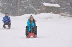 Kids sliding Stock Photography