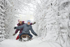 Kids sliding in winter time royalty free stock photo