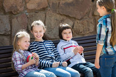 Kids with small ball playing. Happy little kids with small ball playing in city street Royalty Free Stock Photos