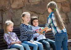 Kids with small ball playing. Smiling kids with small ball playing in city street Stock Photography