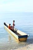 Kids in small boat in Arborek Stock Image