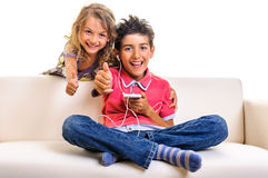Kids with smartphone thumb up Stock Image
