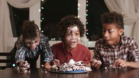 Kids smeared in cake.