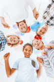 Kids smiling and holding balloons. Happy kids standing in a circle and holding balloons Stock Images