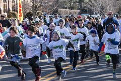 Kids smiling at start of fun run. Garden City, NY, USA – 24 March 2018: Kids Fun Run start at the Run for Tomorrows Hope Foundation 5K, to support Catholic Royalty Free Stock Photography
