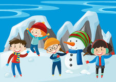 Kids and snowman in the snow field Royalty Free Stock Photos
