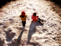 Kids In A Snowy Park royalty free stock photos