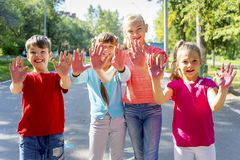 Kids with soap bubbles. Kids blowing soap bubbles on a playground Stock Photography