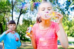 Kids with soap bubbles Stock Photo