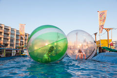 Kids in soap bubbles floating on the water Stock Photography