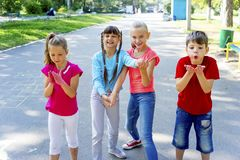 Kids with soap bubbles. Kids blowing soap bubbles on a playground Stock Image