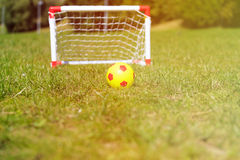 Kids soccer ball and gates on green grass Stock Photography