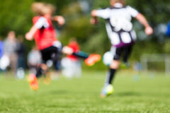 Kids soccer blur. Abstract blur of kids soccer training match during summer time stock photo