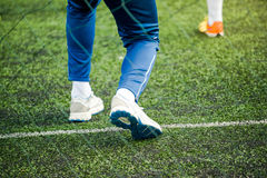 Kids soccer coach on football pitch Royalty Free Stock Images