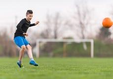 Kids soccer football - children player on soccer field Stock Images