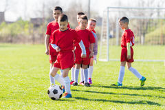 Kids soccer football - children players exercising before match. Kids soccer football - small children players exercising before match on soccer field royalty free stock images