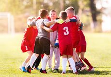 Kids soccer football - children players match on soccer field royalty free stock images