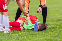 Kids soccer football - children players match on soccer field royalty free stock image