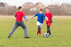 Kids soccer football - children players match on soccer field Stock Images