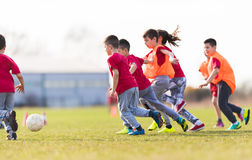 Kids soccer football - children players match on soccer field. Kids soccer football - young children players match on soccer field stock photography