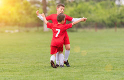 Kids soccer football - children players match on soccer field. Kids soccer football - young children players match on soccer field royalty free stock images