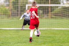 Kids soccer football - children players match on soccer field royalty free stock photography