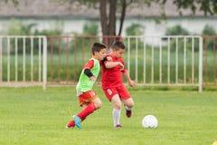 Kids soccer football - children players match on soccer field. Kids soccer football - young children players match on soccer field Stock Photo