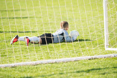 Kids soccer football - goal keeper on the match on soccer field. Kids soccer football - young goal keeper on the match on soccer field royalty free stock images