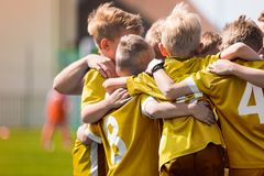 Kids Soccer Football Team Huddle. Children Play Sports Game. Children Sporty Team United Ready to Play Game. Youth Sports For Children. Boys in Sports Jersey royalty free stock photography